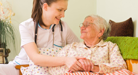 Nurse with an elderly patient at home